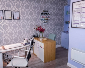 a room in number 10 massage and beauty with an office chair