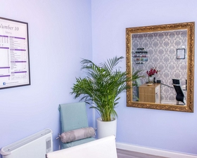 a room in number 10 massage with baby blue walls